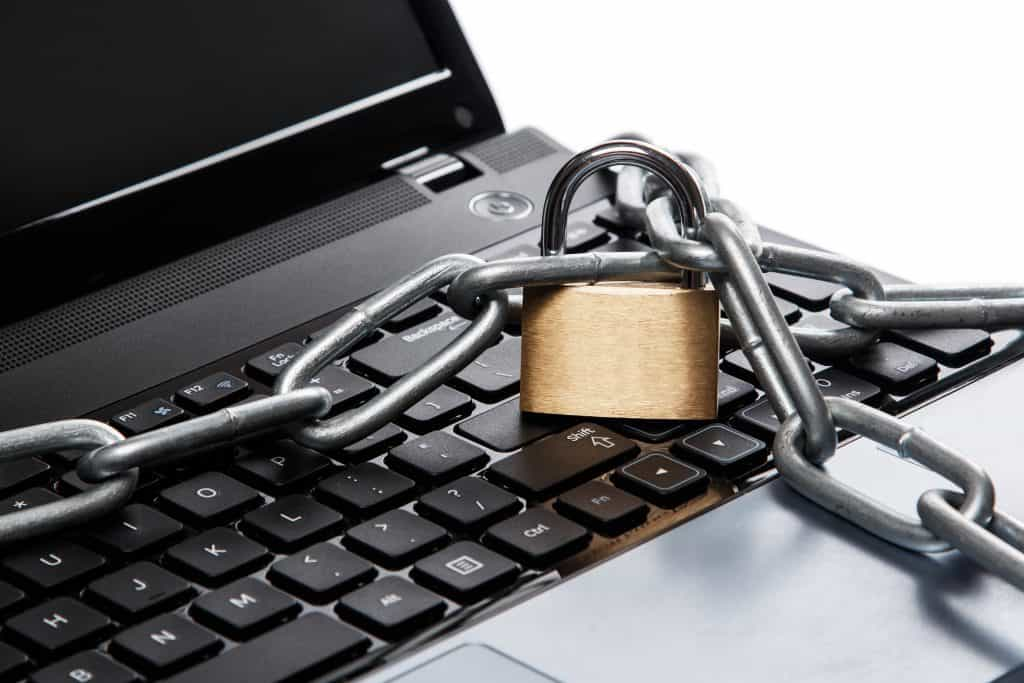 Lock and chain on laptop